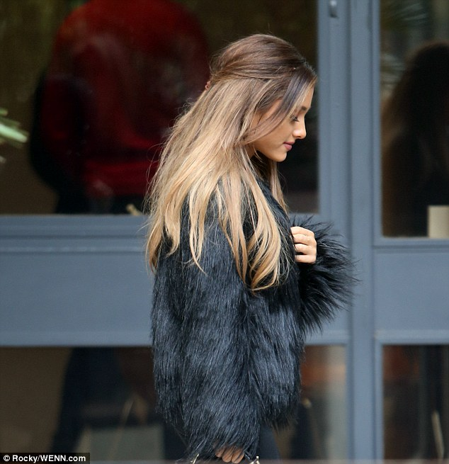 Ariana Grande Steps Out In Fluffy Coat As She Leaves The
