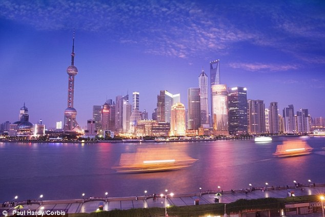 Financial powerhouse: In the last decade alone, the skyline of major cities in China, such as Shanghai (pictured), have been completely transformed as the economy grew in leaps and bounds