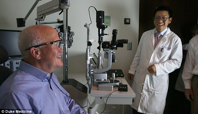 Paul Hahn, MD, a retinal surgeon at the Duke Eye Center, switches on the bionic eye - and 66 year old Larry Hester sees for the first time in 30 years