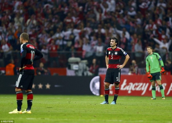 Germany's World Cup winners, including Mats Hummels, are dejected after the final whistle is blown in Warsaw