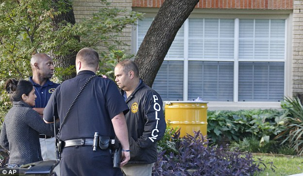 Erie evidence: Police officials, left, and a barrel for disposal of hazardous waste stand by outside the nurse's  residence as neighbors learn what they can and tell officials everything they know about he situation