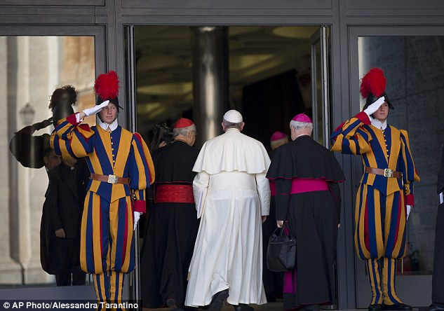 Welcome: Vatican Swiss Guards  salute Pope Francis as he arrives for the synod last week