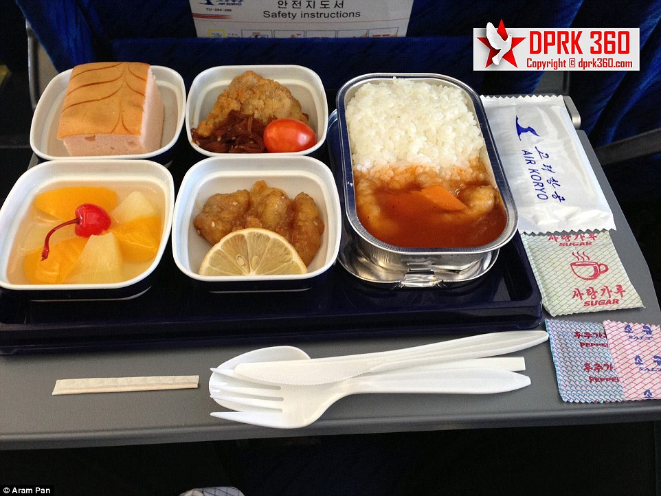 The in-flight meal featured rice and chicken and fruit cocktail for desert. 'The food is better than I expected,' Mr Pan commented