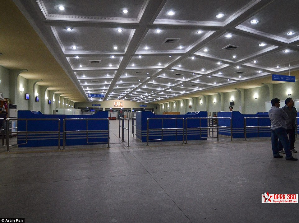 The airport customs area looks remarkably quiet in North Korea and only one man appears to be working at the desks