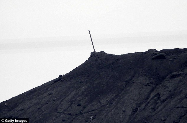 In a symbolic victory today, the ISIS flag was torn down from a strategic hillside where it had been flying for more than a week