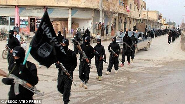 The National Union of Students has come under fire after it refused to condemn ISIS - because of fears it was 'Islamophobic'. Fighters from ISIS are pictured marching in Raqqa, Syria