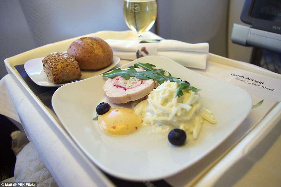 Setting the standard: Lufthansa's elegant business class hors d'oeuvres is stuffed free-range chicken with Sel rose, a type of curing salt, accompanied with a creamy kohlrabi salad with blueberries and rocket. A glass of white wine and two bread rolls are on the side