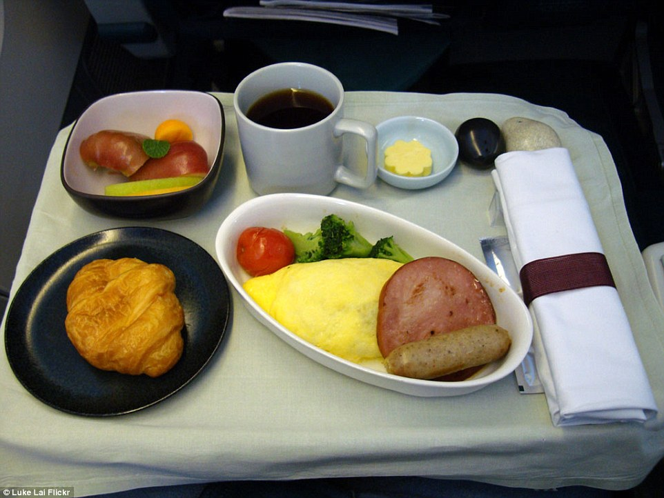 Top marks for presentation: Cathay Pacific's business class breakfast is an exercise in minimalism. A neatly folded omelette is served with a single slice of ham, one chicken sausage, a lone tomato and three brocolli florets. A soft crossaint, a small salad and a mug of coffee completes this airline's simple repast
