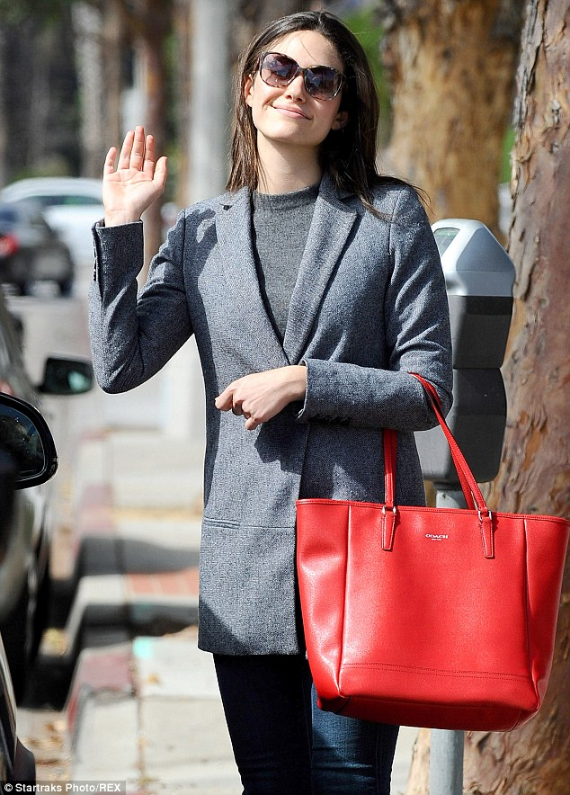 Emmy Rossum Adds A Pop Of Colour To Her Outfit With A