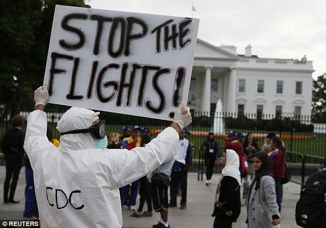 Demonstration: A protester stands outside the White House, urging the Obama administration to ban all flights into the United States to prevent the spread of the Ebola virus