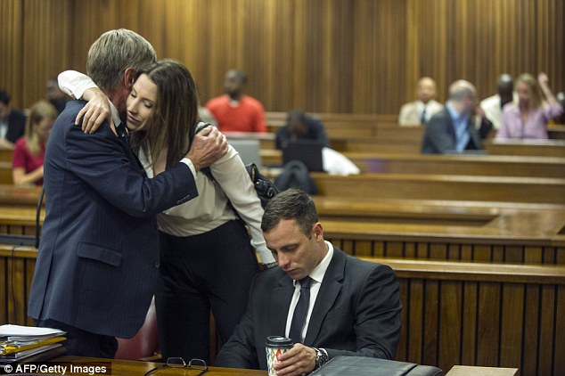 Loyal support: Oscar Pistorius's sister Aimee is greeted by one of the athlete's defence lawyers, Brian Webber, before the start of her brother's sentencing hearing at the high court in Pretoria