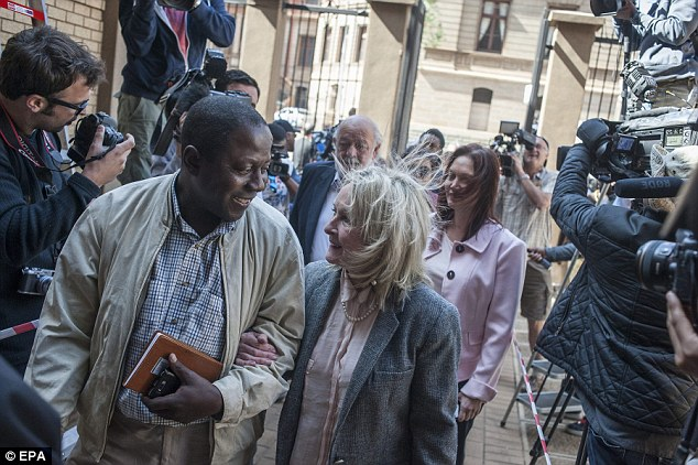 Reeva Steenkamp's mother, June, is accompanied to the high court in Pretoria court by an unidentified man