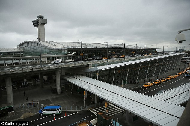 Airport: Flight attendants called the CDC, Port Authority and customs officials, who boarded the plane in protective gear as it touched down at JFK (pictured), forcing 145 worried passengers to remain on board