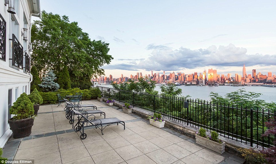 Idyllic: The new owners can recline among the shrubbery on their private terrace while taking in the buzz of New York City