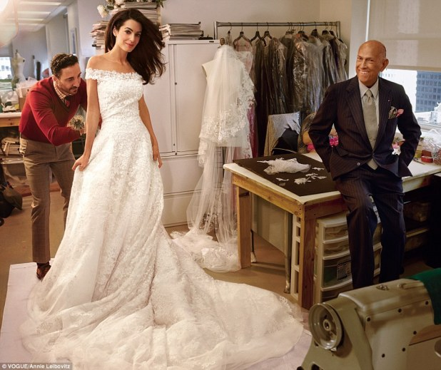 Great loss: Oscar de la Renta, who recently designed Amal Clooney's wedding dress, has died at the age of 82. He is pictured with Amal in a photo shoot for Vogue