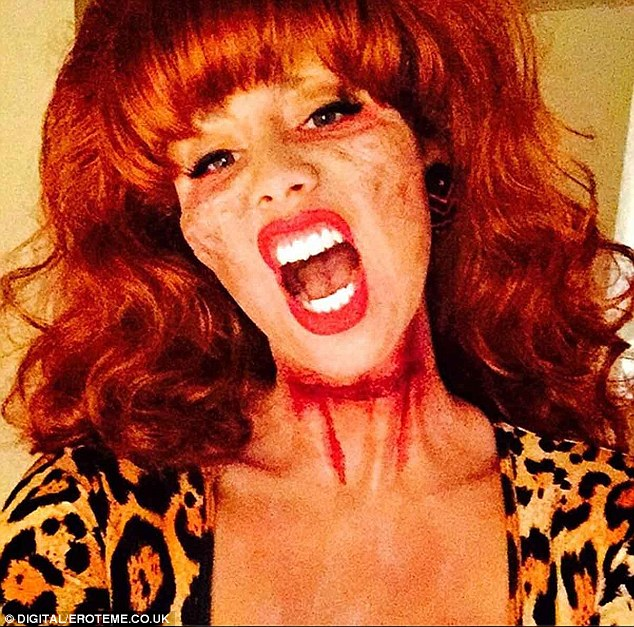 Birthday girl: Amber Rose dressed up as a zombie version of Married...With Children character Peggy Bundy, joking on Instagram: 'Al killed me so I came back as a zombie to eat his Brains #ZombiePegBundy'