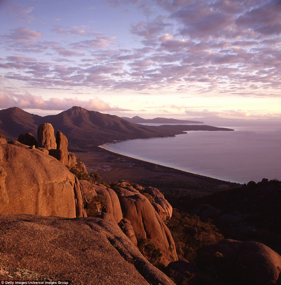 The Freycinet Peninsula is bathed in stunning light in the late afternoon. Almost 1.6 million people visited its shores in the last year
