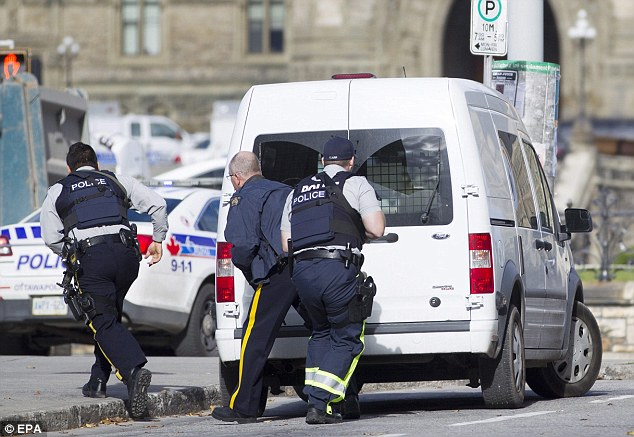 Rush: Emergency responders attempt to secure a portion of downtown Ottawa near Parliament Hill