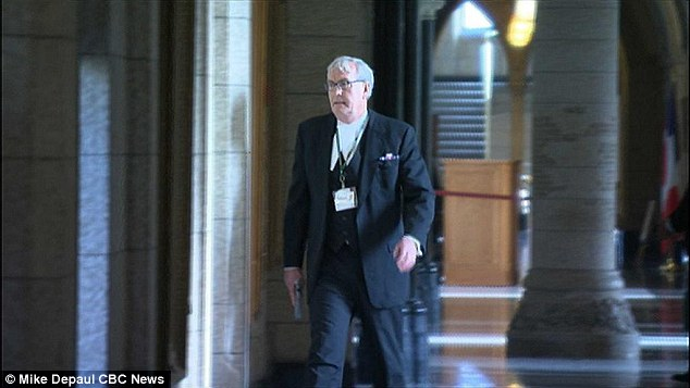 Hero: Kevin Vickers shot dead Bibeau after his deadly rampage on Canada's parliament. The security chief has his own weapon, pictured, and is a former police officer