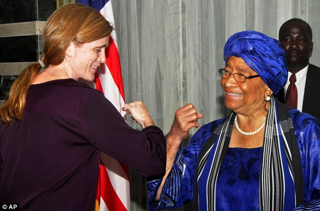 Liberia's President Ellen Johnson Sirleaf, right, gives U.S. Ambassador to the United Nations Samantha Power what is know as the 'Ebola handshake' during a news conference in the city of Monrovia on Tuesday