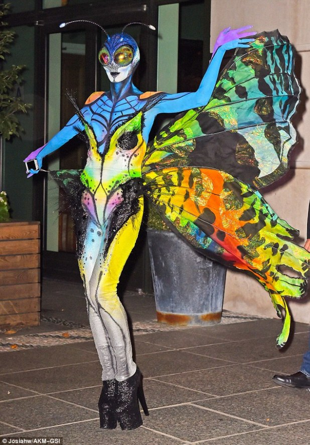 Gossamer wings: Heidi Klum dressed up as a beautiful - and bizarre - butterfly for her annual Halloween bash
