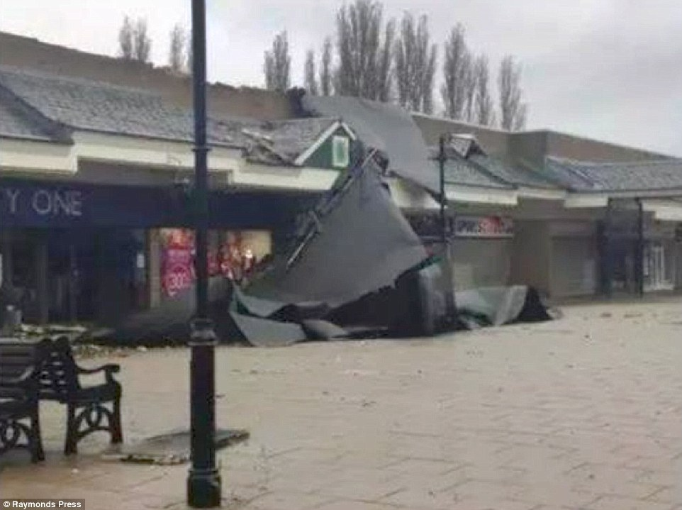 Wrecked:Roof tiles came crashing down into the street, damaging cars, and bins were sent flying through the air