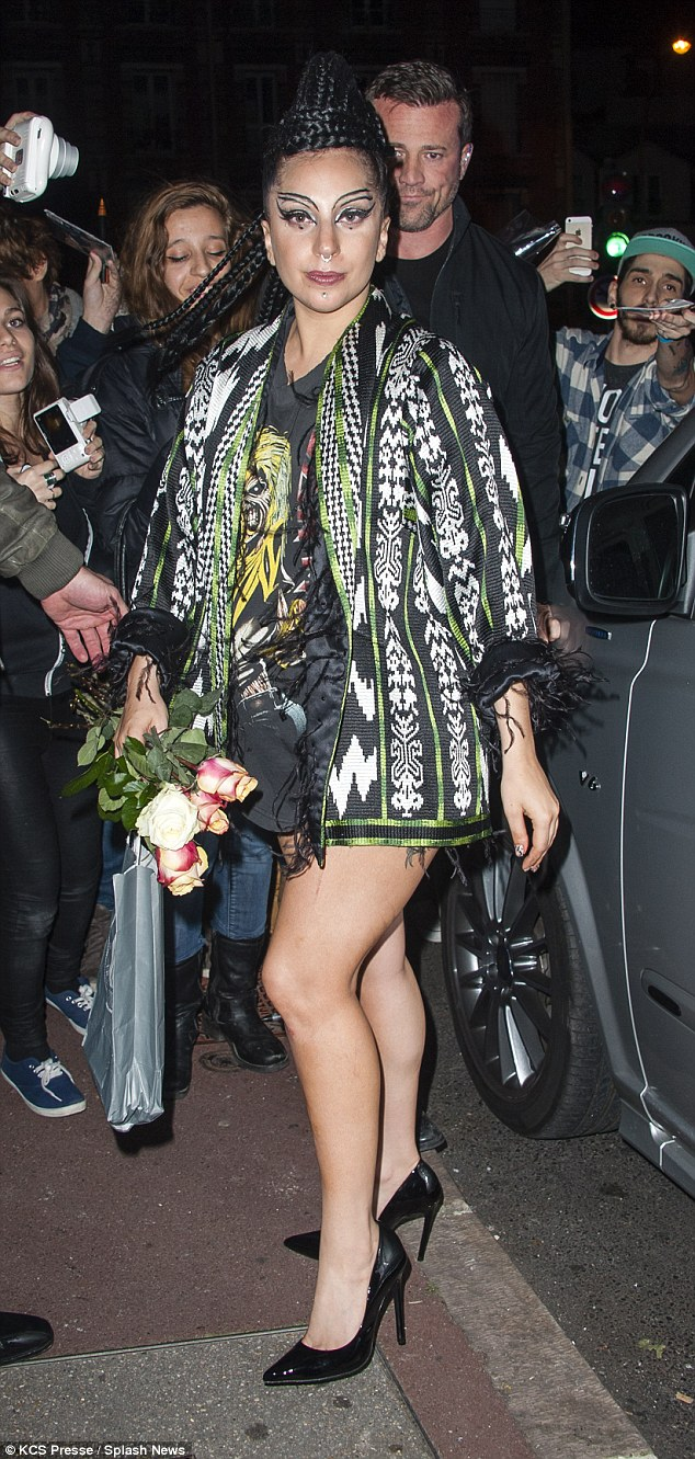 She's gone gaga: Lady Gaga ventured out in yet another eccentric look as she greeted a crowd of her fans outside the Zenith in Paris, France on Saturday evening