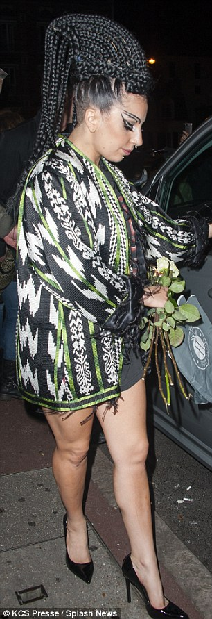 Wacky hairdo: Gaga has been sporting black braids during her stay in Paris, pulling them up into a beehive