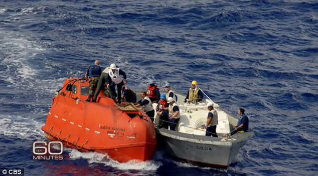 Real life: Footage of the actual rescue of Captain Phillips from Somali pirates, which was led by O'Neill