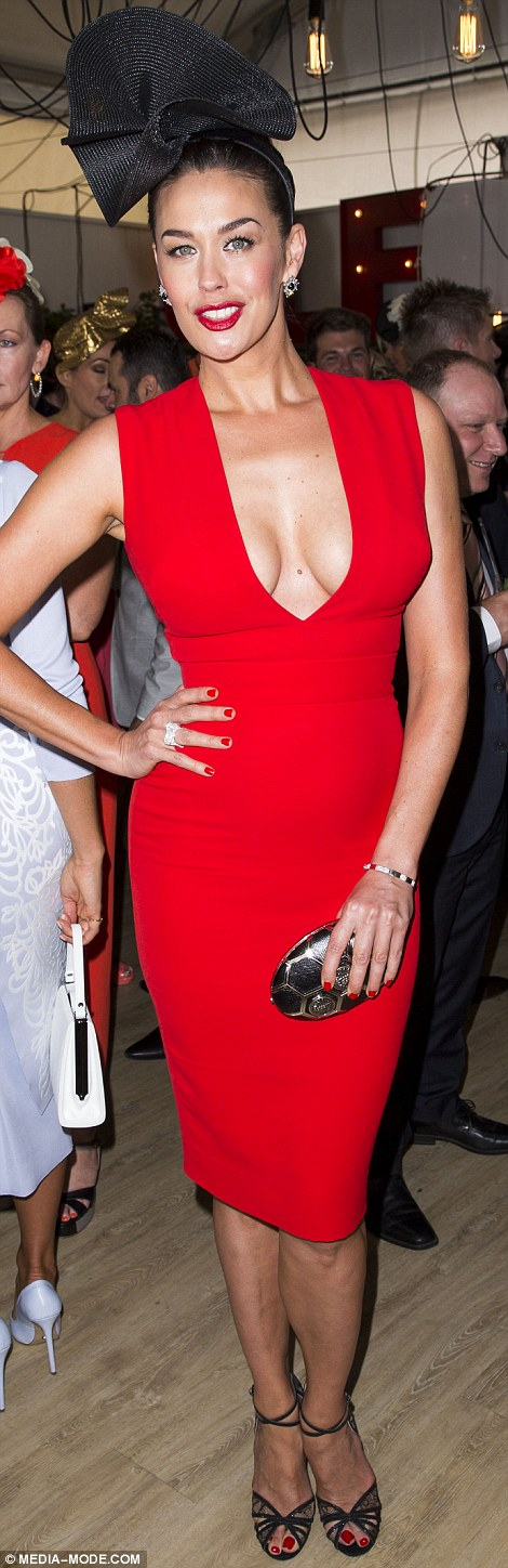 Model figure: Flaunting her enviable curves, the 39-year-old sported a sultry scarlet Victoria Beckham dress that fitted her figure perfectly
