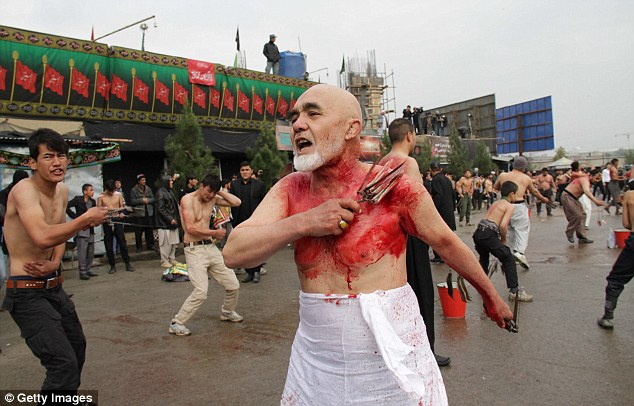 This man flagellates himself during the festival in Kabul, Afghanistan to commemorate Imam Hussein's death