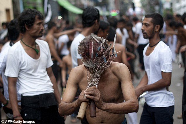 This man in Myanmar has attacked several knives to some chains for his self flagellation device