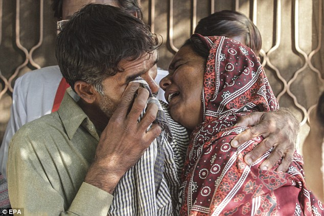 Their relatives are seen grieving for the couple in Kot Radha Kishan, Pakistan in 2014