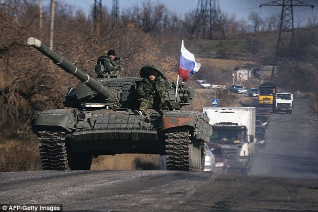 Crossing the border: A Russian army convoy with 32 tanks has entered Ukraine despite a ceasefire, Ukraine's military claimed today. Pictured: A tank being used by pro-Russian separatists in Ukraine on October 28