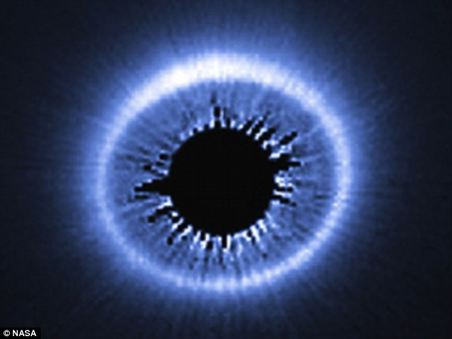 Captured by the Hubble Space Telescope, this image shows the huge dusty debris discs around a star called HD 181327, showing a huge spray of debris possibly caused by the recent collision of two bodies into the outer part of the system.