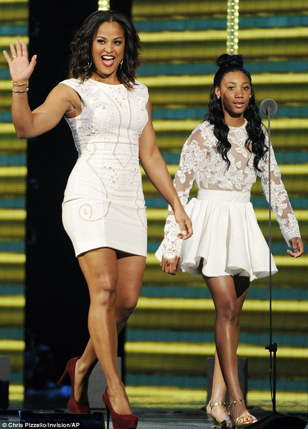 All-white: Laila and Little League pitcher Mo'ne Davis took to the stage together