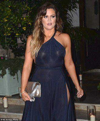 Flashing those famous Kardashian curves! The 30-year-old went braless under her semi-sheer midnight blue gown, which featured a Grecian-style one-shoulder detail and a revealing thigh-high slit