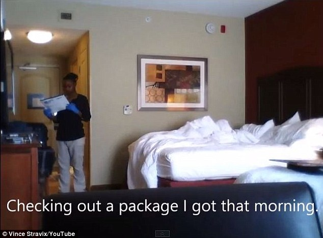 You've got mail: The housekeeper was caught on camera reading the details on a package that was delivered to the guest