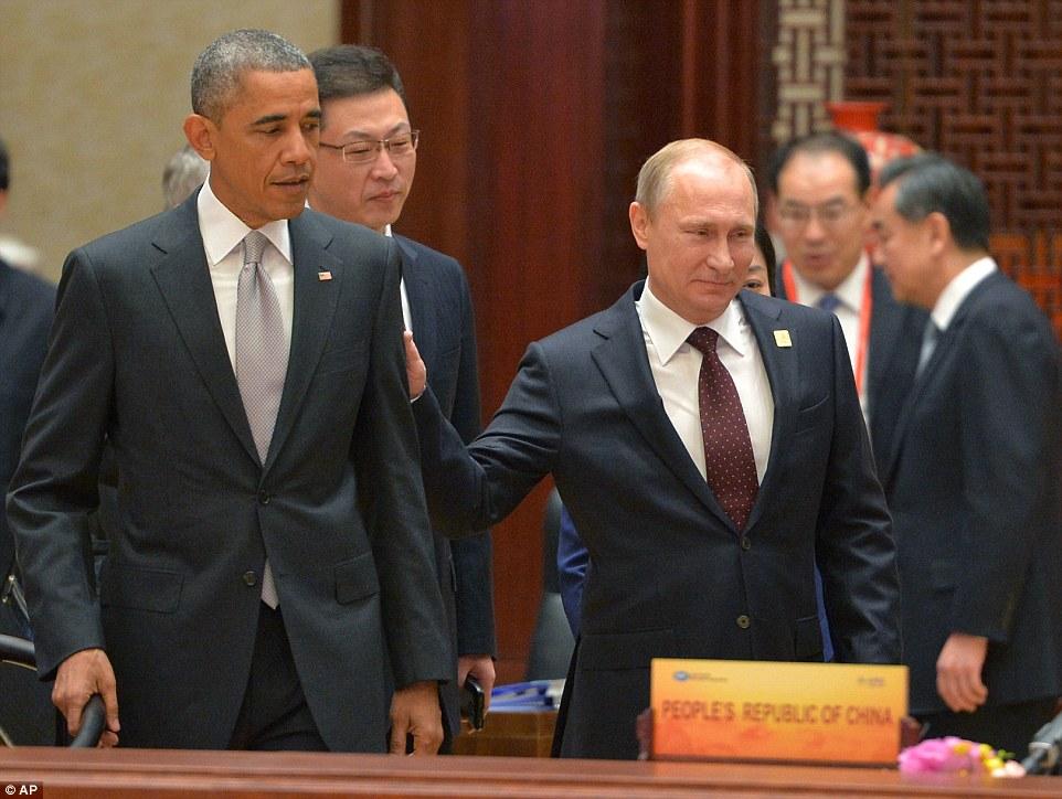 Russian President Vladimir Putin walks past US President Barack Obama at the APEC Summit