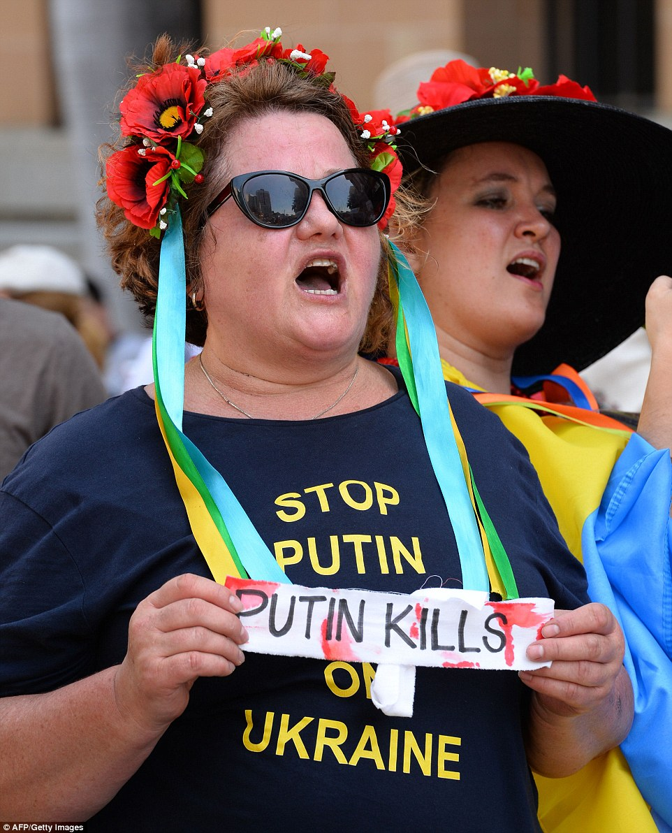 Outside the Brisbane Convention and Exhibition Centre where the Summit was held, the Russian President faced a hoard of protesters