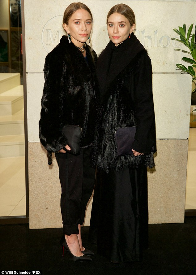 Twinsies: Mary-Kate and Ashley Olsen stayed warm and similar in luxurious furry black coats at the Marion Heinrich store opening in Munich, Germany on Thursday