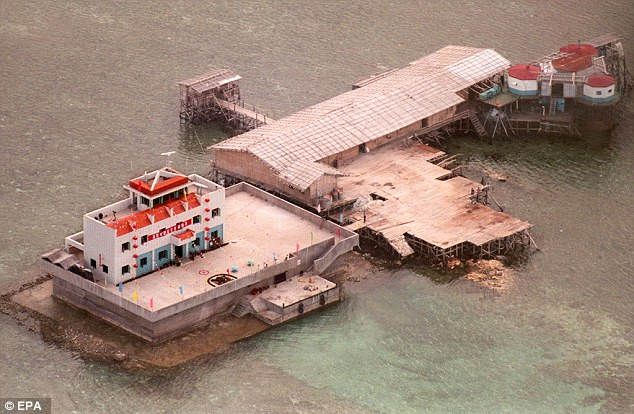 An aerial photograph taken in 1999 shows Chinese workers building on sparse land in the Spratly Islands