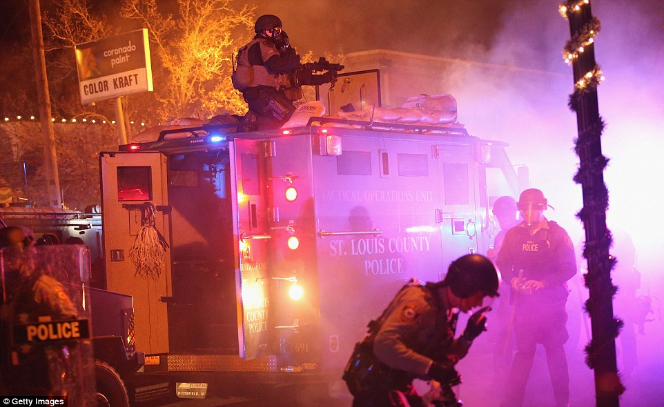 Disruption: Police confront protestors in Ferguson using armored vehicles and riot shields