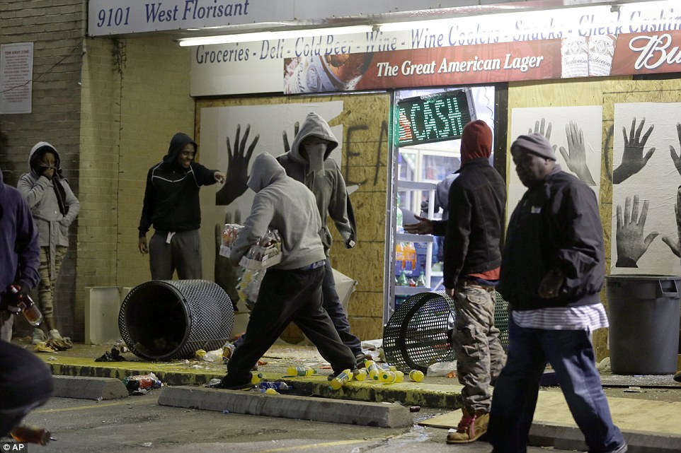 Free stuff: Ferguson Market and Liquor store is vandalized after the announcement of the grand jury decision Monday on November. 24, 2014, in Ferguson, Missouri