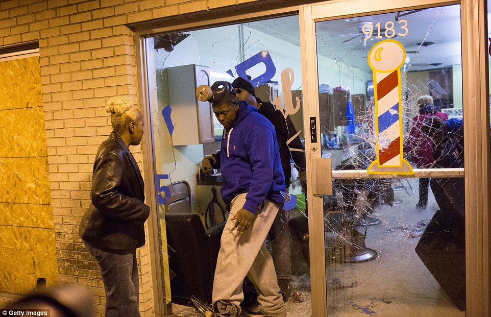 Taking stock: Concerned business owners survey damage suffered during rioting in Ferguson