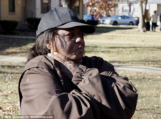 Devastated: Renita Towsn, the grandmother of DeAndre Joshua at the scene in the Northfield apartment complex where he was found dead the morning after the unrest following the grand jury decision not to indict Officer Darren Wilson in the shooting of Michael Brown in August