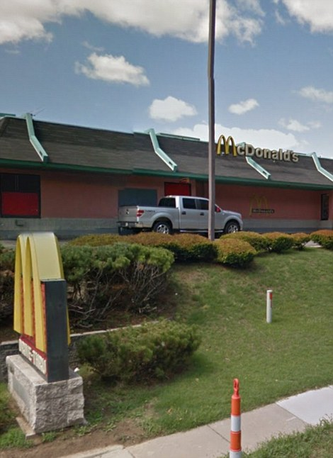 Attacked: McDonald's on West Florissant was smashed up although not set on fire. It had previously avoided damage