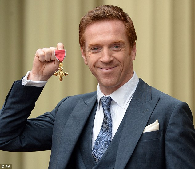 Chuffed: Damian was awarded an OBE at Buckingham Palace on Wednesday afternoon for his contribution to acting