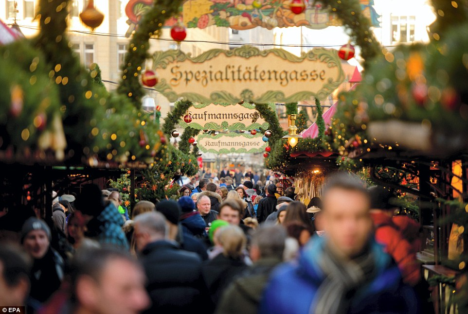 Festive season: Revellers walk around the Christmas market at the Rathausmarkt in Hamburg