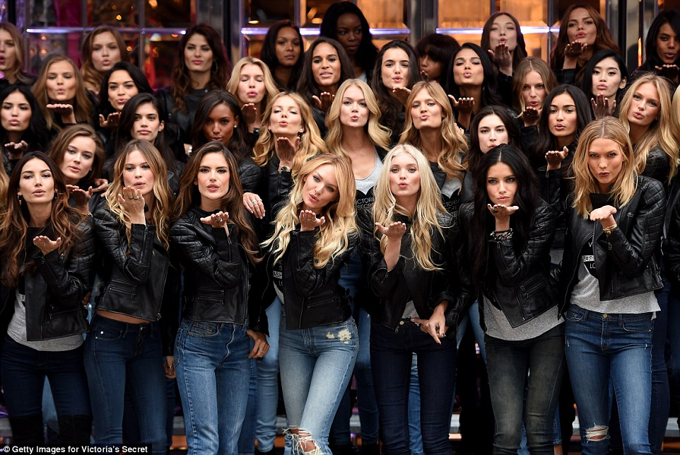 Kiss off: The irresistible troupe kept photographers entertained outside the New Bond Street store